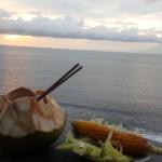 Menikmati air kelapa dan jagung bakar di pinggir jalan pesisir pantai Senggigi